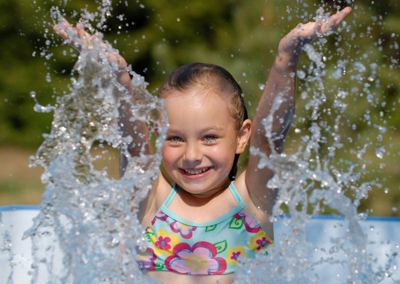 girl splashing water in the air