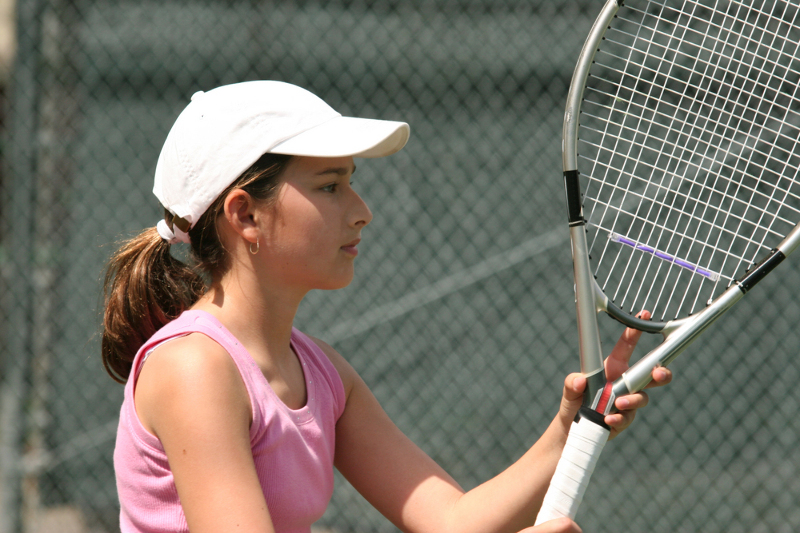 teenage girl playing tennis
